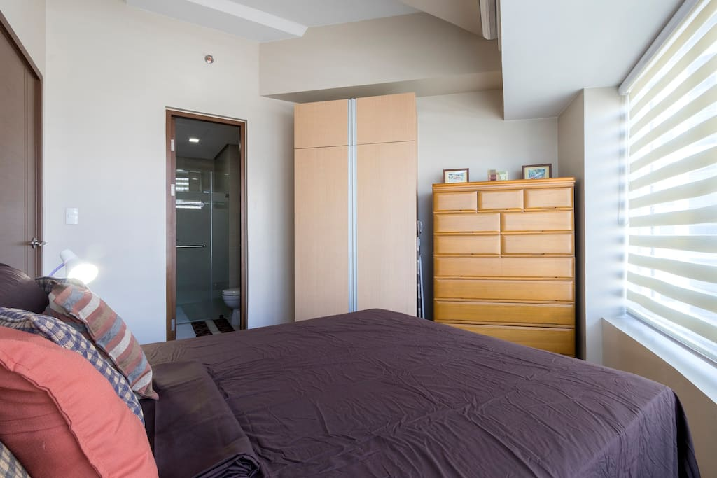Very comfortable double bed with a pullout single bed for you to sleep like a baby. Two large closets with hangers provided for you!