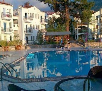 Modern hotel rooms with  pool view - Ölüdeniz Belediyesi