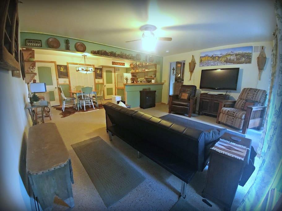 Living room with door to King bedroom + bathroom