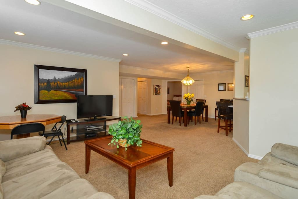 Family room with sectional, TV, open to kitchen