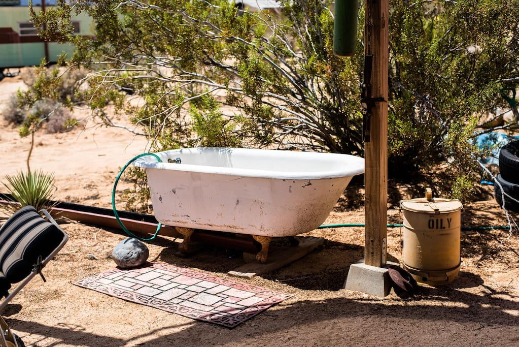Cool off in cold water claw tub on patio. Will be part of outdoor solar bathhouse in a few months.Fills with the hose bib at right front corner of the trailer.