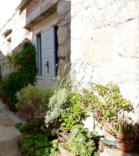Your home on Vis is behind these traditional white wooden door.