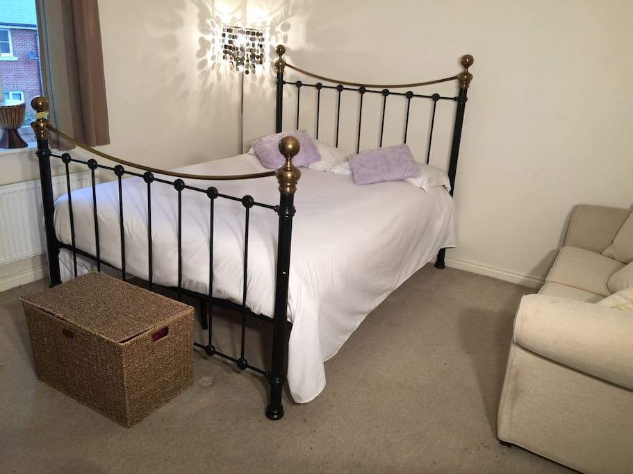 King size mattress in our double room with sofa, drawers and wardrobe.  Extra beds at your request
