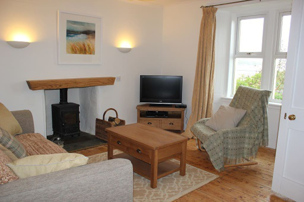 Main living room with loch views, wood burner, TV/DVD, sanded floor and local artwork