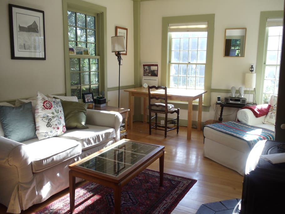 Brightly sunlit room for relaxing, located adjacent to the kitchen.