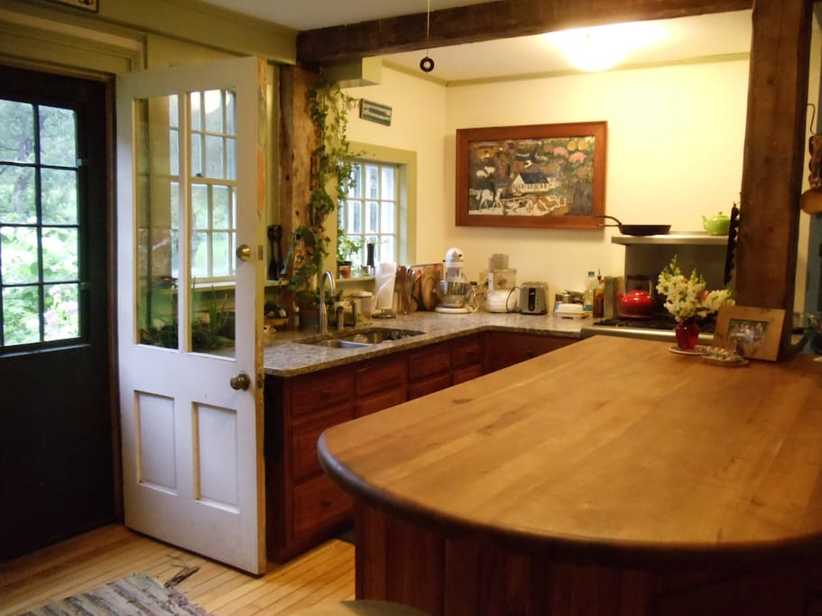 Kitchen with door to backyard.  The island was handmade by a local Vermont craftsman.  The cherry wood came from his back yard.