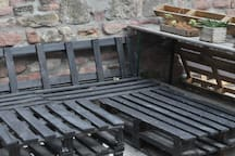 Our outdoor space has diy furniture made from pallets, we do have extra cushions for them.