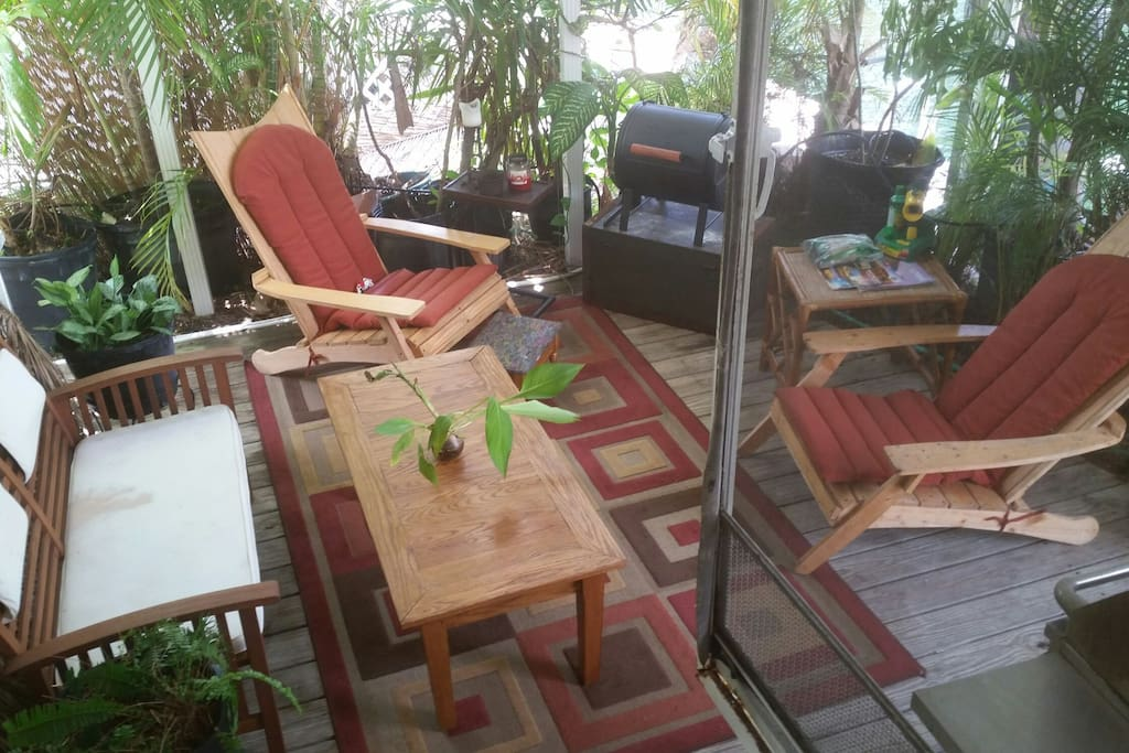 Loaded with plants, 2 bbq grills, celing fans, lights. A perfect oudoor getaway. Let the rains come, its covered!