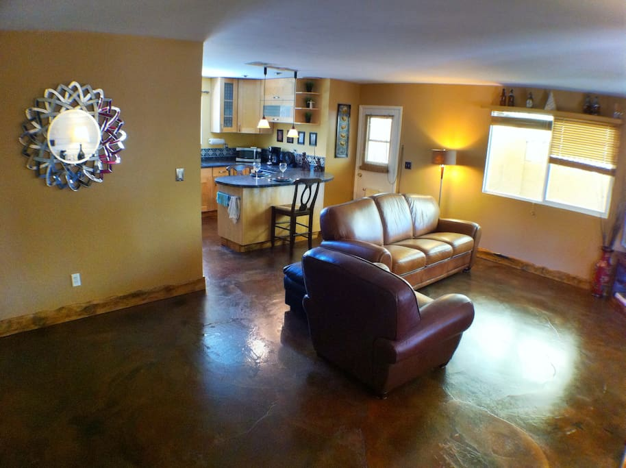 Stained concrete and hand carved baseboards provide an artsy feel.