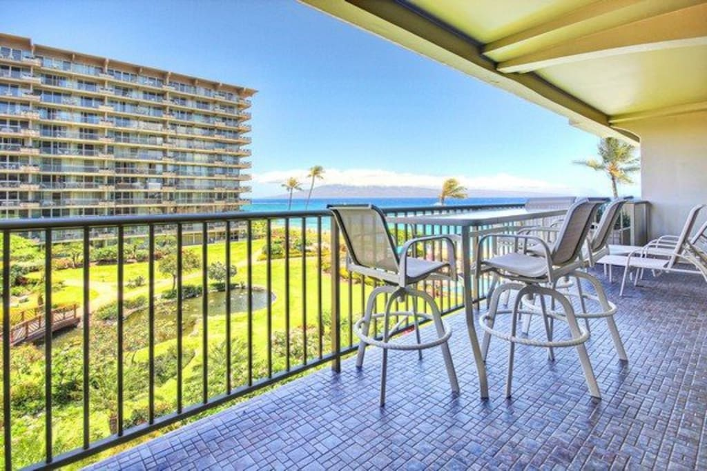 Spacious lanai with patio furniture