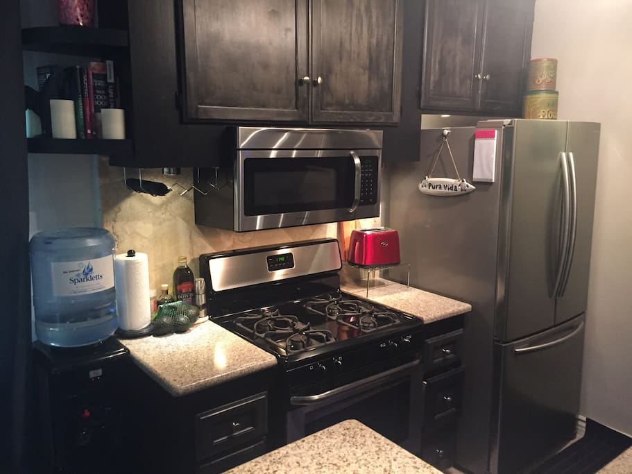 Kitchen has all stainless steel appliances (Samsung refrigerator, dishwasher, stove, microwave), new granite and stone floor and backsplash.  It also has cabinetry lighting.