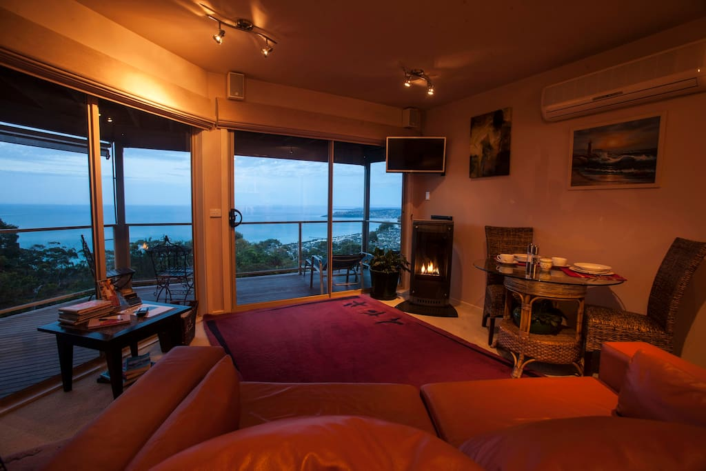 Summit Views Lounge aspect from custom leather sofa at dusk with elegant Gas log fireplace