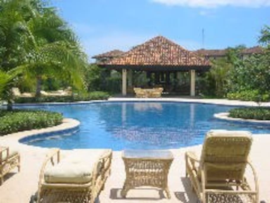 Large pool and exercise room next to the villa.