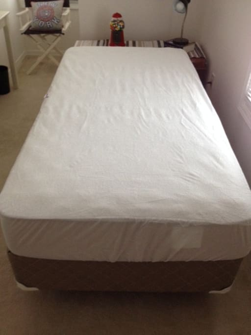 Mattress protector washed after each guest.