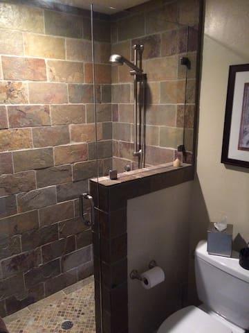 Tile shower in recently remodeled bathroom