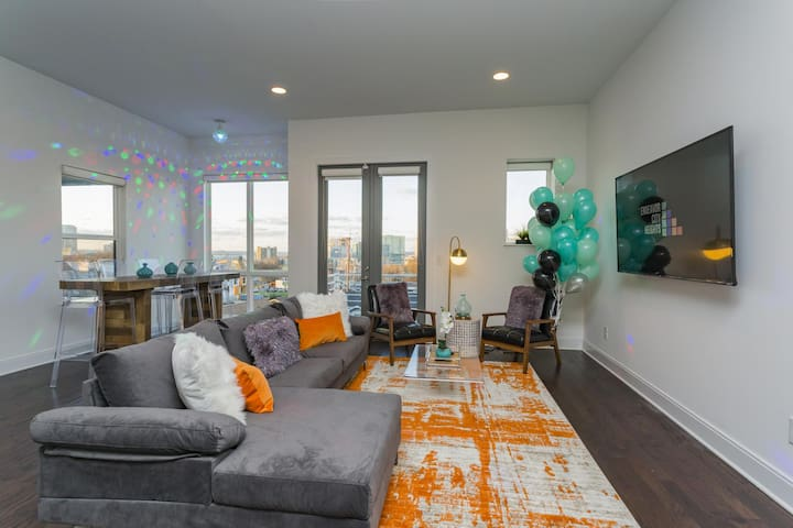 Posh Living Area with Giant Disco Ball and Club Lighting