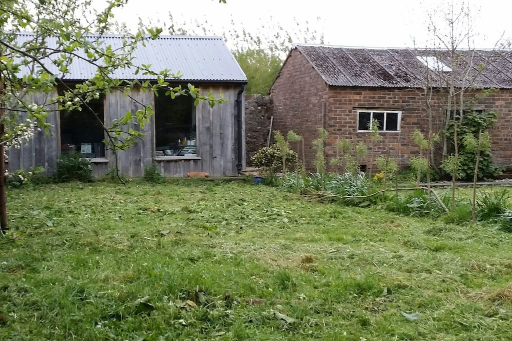 The Garden Studio in the walled garden (left hand side). Clad in rare Scottish grown cedar, roofed by vernacular galvanised sheeting. (locally sourced - 100% Made in Scotland)