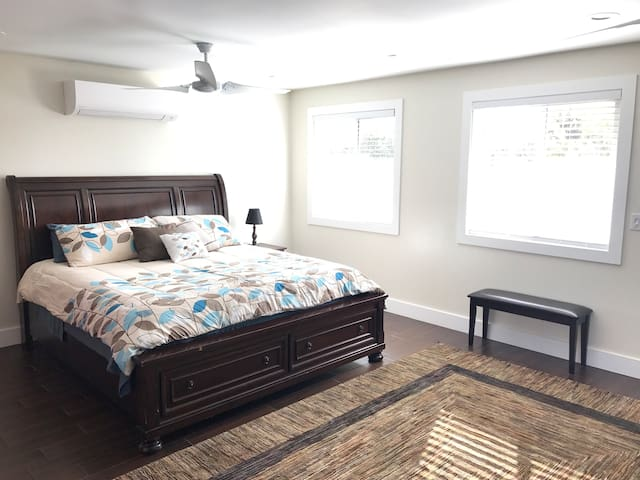 Bed with 2 drawers in front of bed frame
