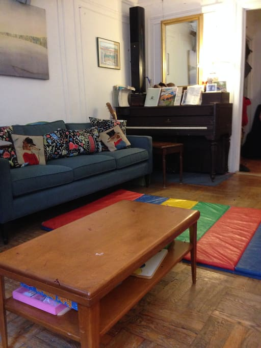 Our living room is large and comfortable.  Piano, toy piano and many percussion instruments provide music making opportunities in your down time.