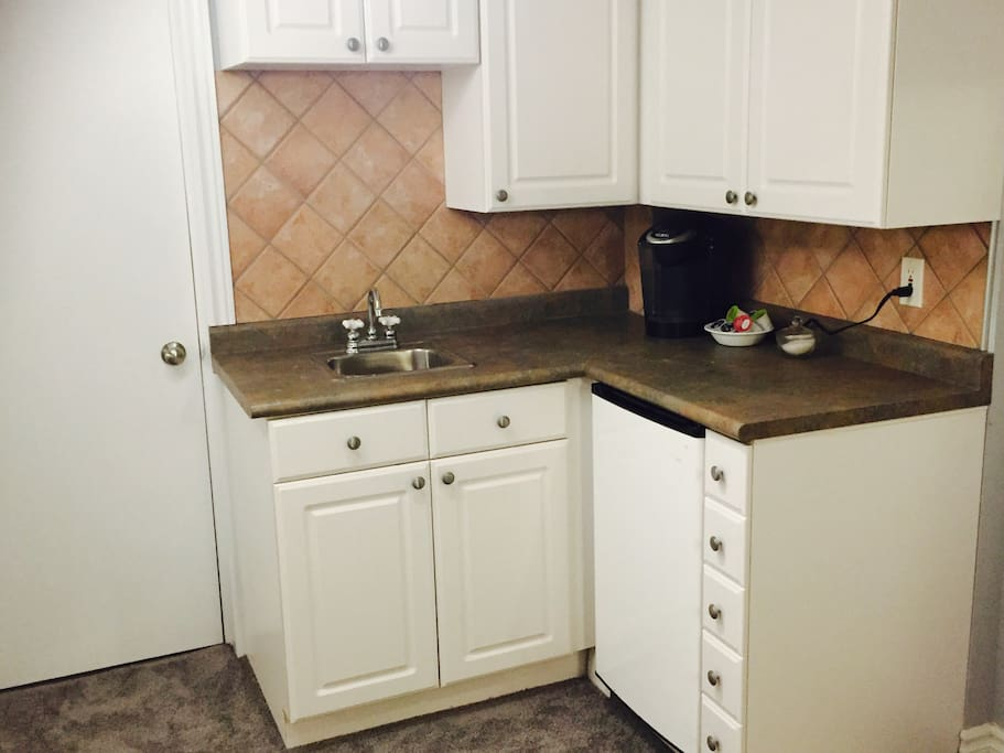 Kitchen -sink, mini fridge, Keurig  coffee maker, dishes, utensils etc.