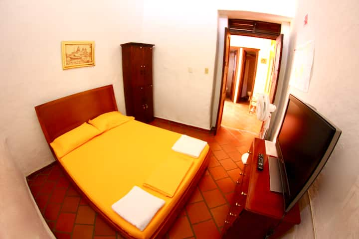 Double bed, shared bath.