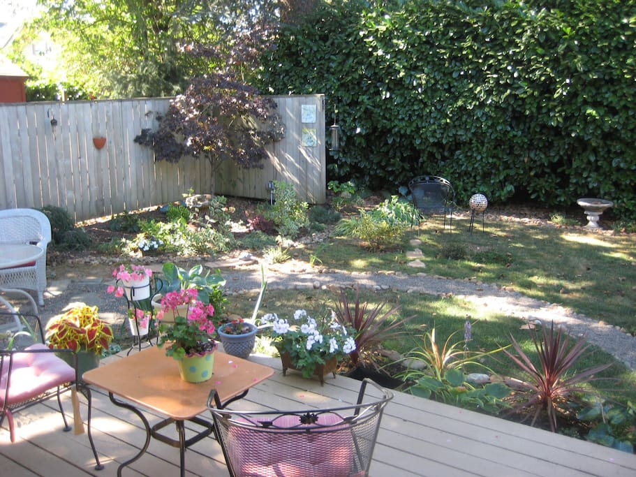 Corner of deck looking into back yard.  Very relaxing to sit out there.