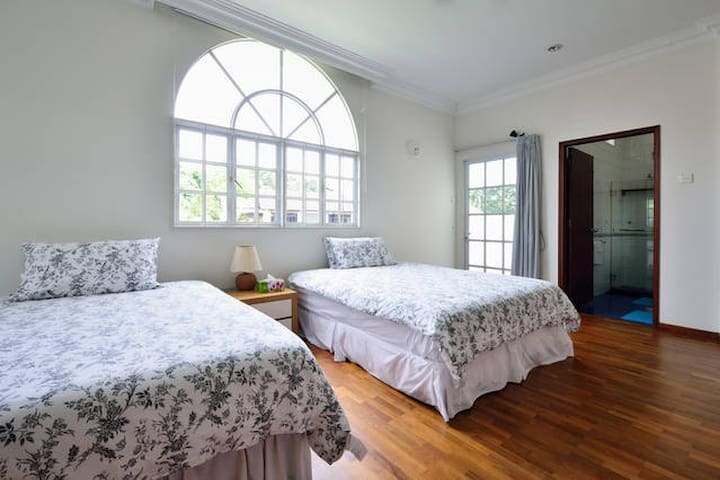 Large bedroom with two new queen size beds