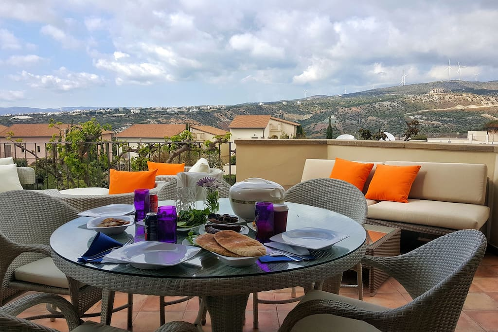 Terrace with dining area and BBQ facilities. Swimming pool view, mountains view.