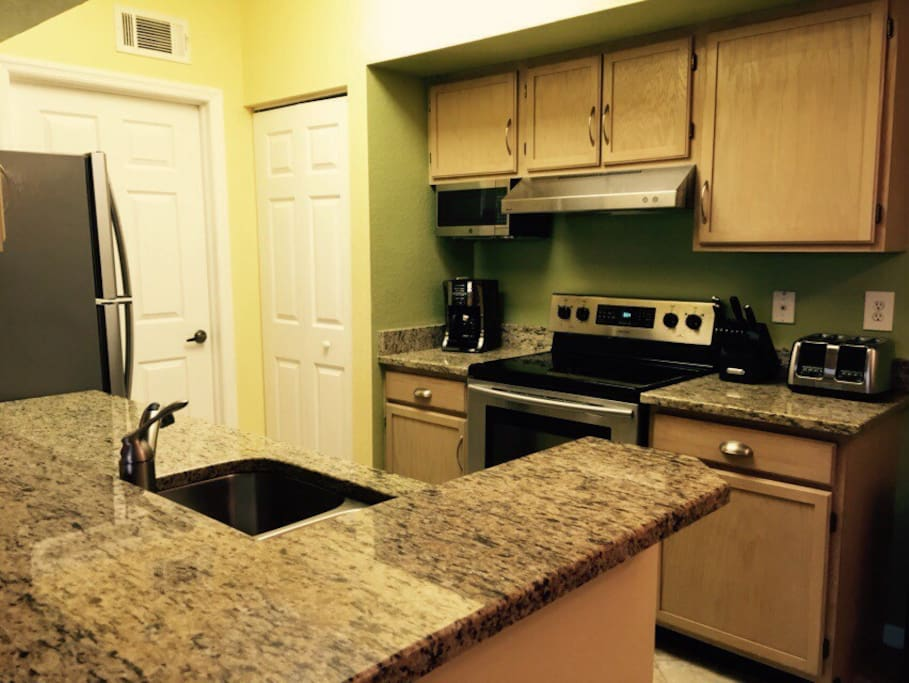 Fully equipped kitchen with granite countertops and new stainless steel appliances