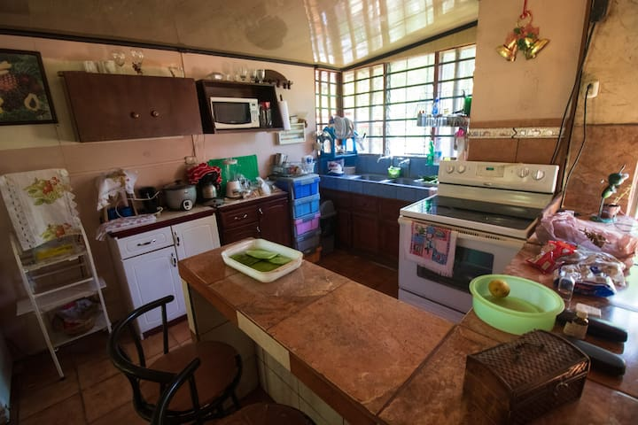 This is the kitchen. From there you can see the pond. It is equipped for you! :)