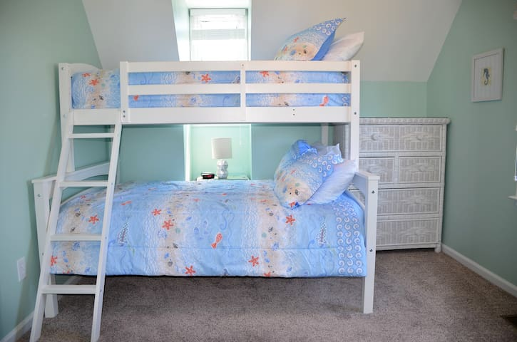 Upstairs bedroom with twin over full bunk bed with ocean view
