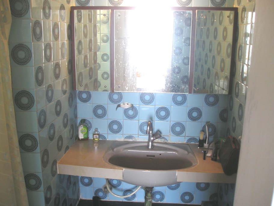 The attached private bathroom.