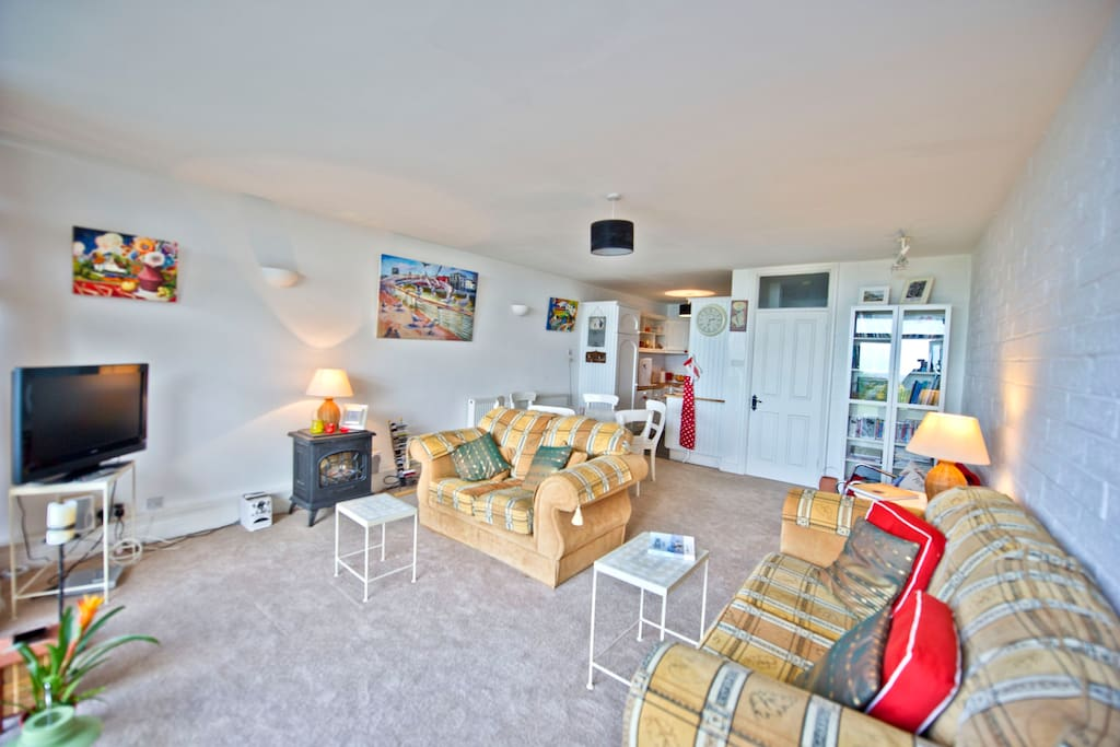 Living area with comfy sofas and view over Dublin Bay