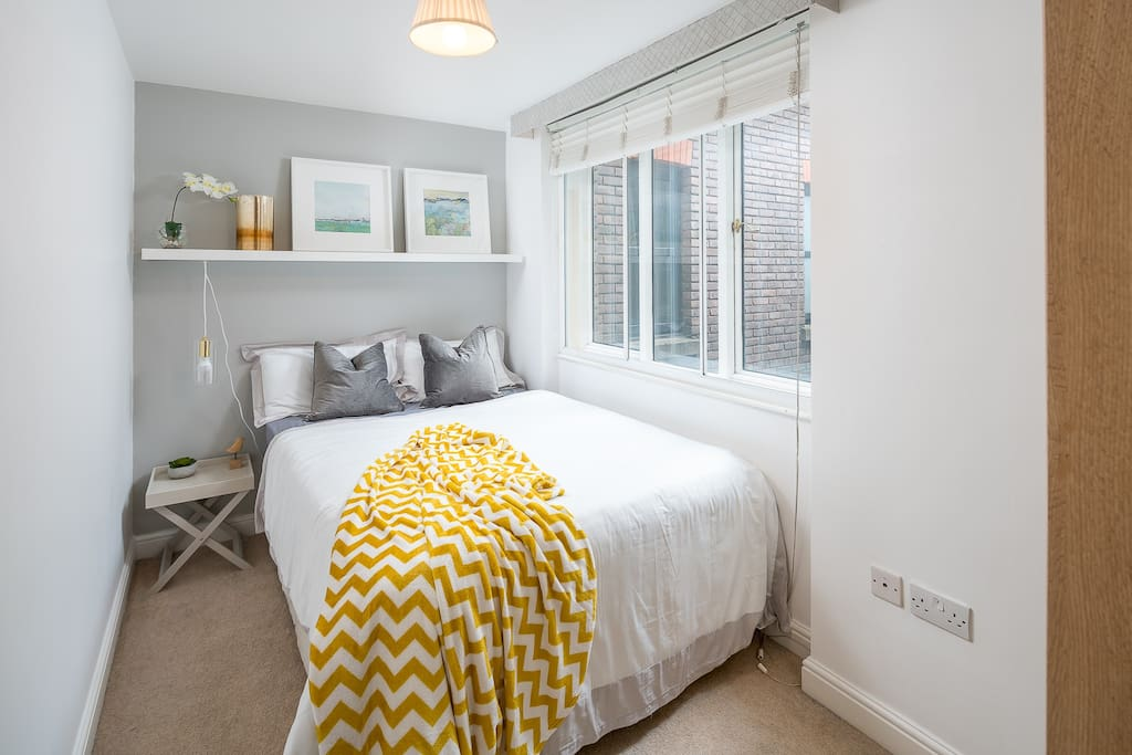 Bedroom #1 with a large double bed. The bed has a memory retention foam/mattress topper for extra luxury that guests just love. Ample space in the large wall-fitted cupboard for your clothes and accessories