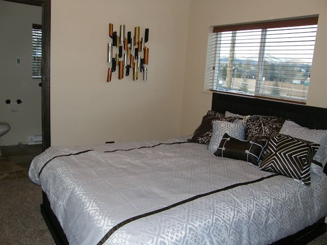 Bedroom with attached bathroom. Queen sized mattress was replaced in 2019.