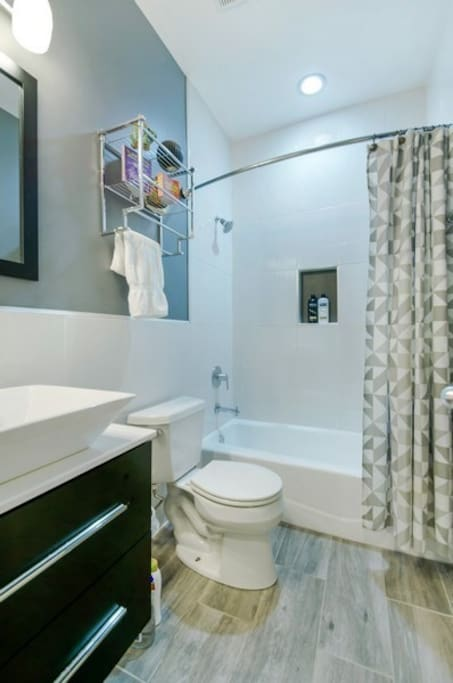 Enjoy your PRIVATE en-suite master bathroom with tub and shower and top-of-the-line Moen and Hansgrohe fixtures.  Your bathroom comes with body wash, shampoo, luxurious toilet paper, generous quantity of bath towels and hand towels, as well as a hair dryer.