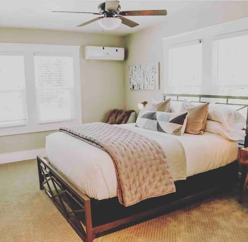 The Walnut Suite has a queen bed and designated quiet workspace with plenty of space and light