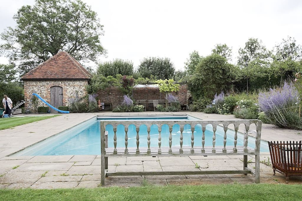 Swimming pool with separate kitchen, changing rooms and outside fireplace