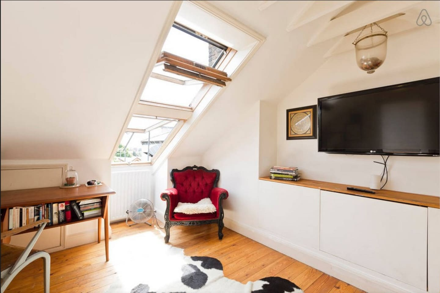 Bright room overlooking canal with big TV