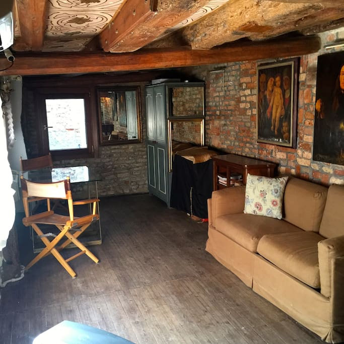 living area seen from  the other side , writing desk next to window
