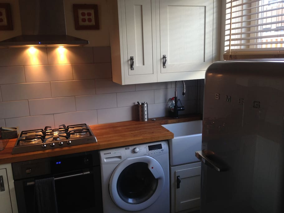 New kitchen equipped with butler sink, washer/dryer, smeg fridge, freezer and all the mod cons.