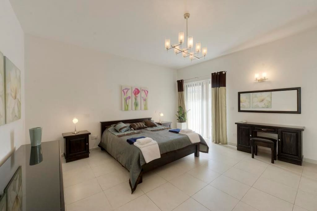The main bedroom with en suite shower and private terrace
