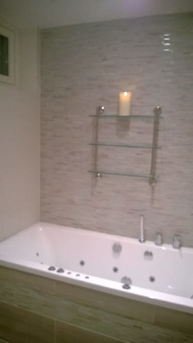 Luxorius class and marble tile bathroom with Rain Shower and Jacuzzi