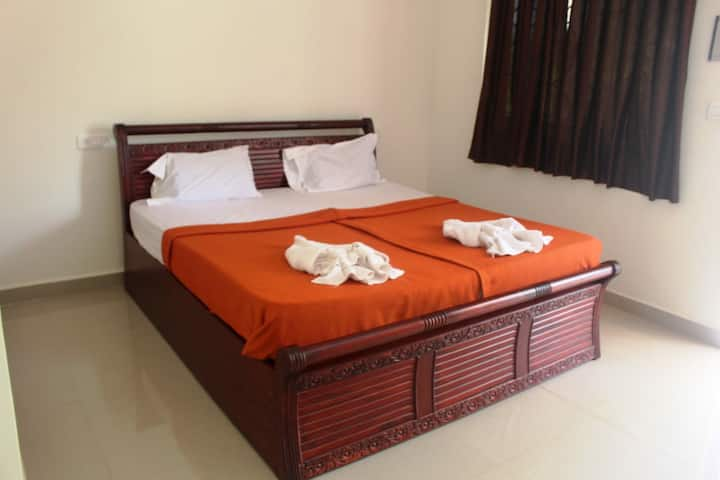 Deluxe room at ashvem beach with swimming pool