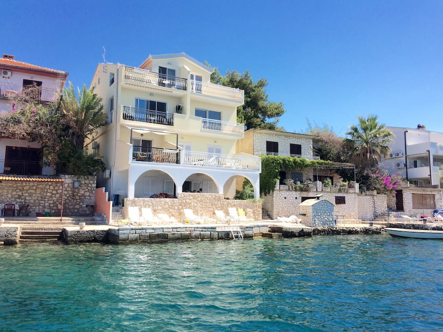 View of the house from the seaside. Apartment Matea is on the first floor on the left (balcony with white shade)