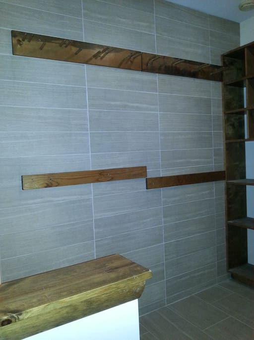 Front entry with tile wall for ski hanging indoors