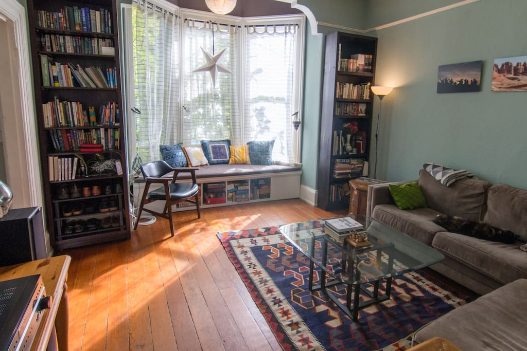 Our living room also has a great window bench for ready and lots of board games and books you're welcome to use during your stay.