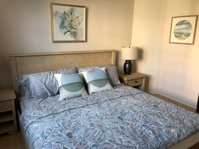 The bedroom has king-size bed and smart television.
