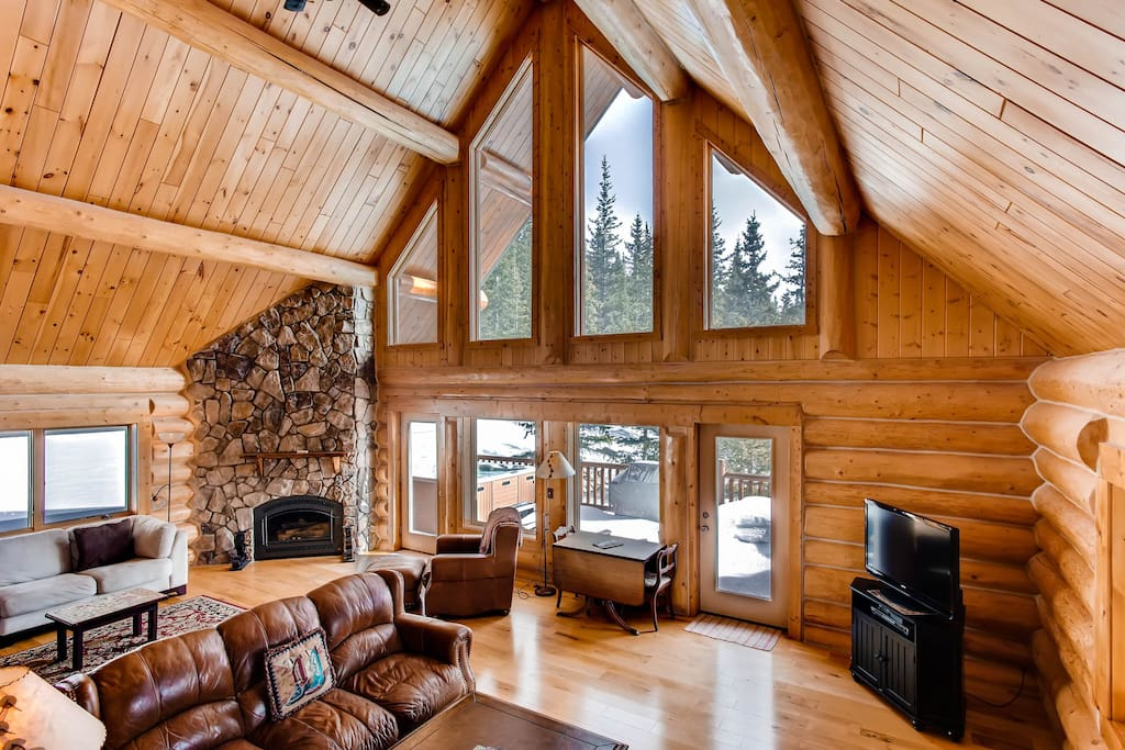 The stone fireplace and the two-story windows are one of the most beautiful features of the home.