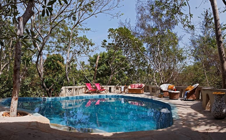Relax by the plunge pool on the sunbeds.